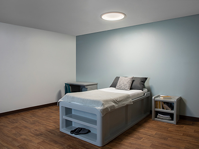 Symmetry behavioral health luminaire in a patient room