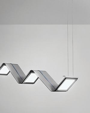 This graceful architectural lighting fixture has a flowing appearance with a uniform OLED lighting source to augment ambient light levels without overwhelming the eyes.