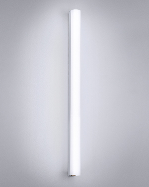 Voila can be used as a vanity or wall architectural lighting fixture. With its sleek styling, the horizontal profile reveals the open void of the cylinder.
