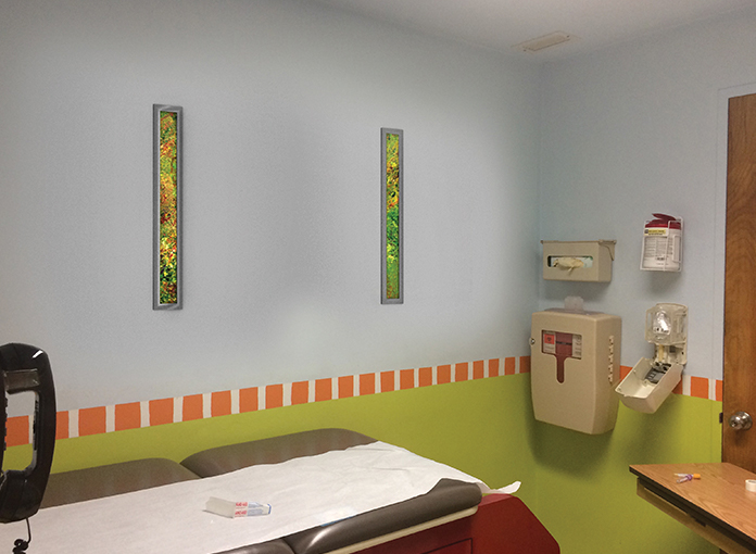 Illuminated artwork for soothing a patient in an exam room